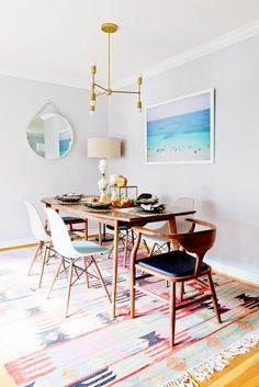 Midcentury modern design in dining space with beach artwork