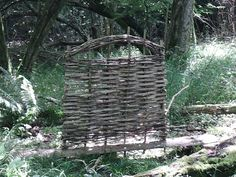 A beautiful hazel hurdle, still on the special board which is used to make them.