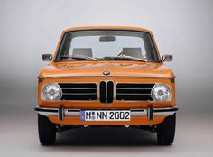 "Orange BMW 2002 - This was my first ""want"" car. It could go all day at 100 mph!"