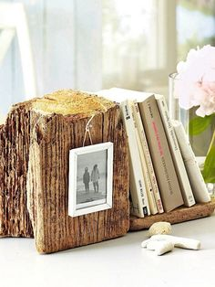 Tack a small nail and hang a photo frame. Use it as a bookend, like they did here or just an accent on the mantel, side table or foyer table. You could even use our zinc numbers to display a special date on the wood. An upcoming holiday, birthday or anniversary. And if you can't find a piece of beach wood, you can create the same look with old wood. Check your local lumbar or salvage yards.