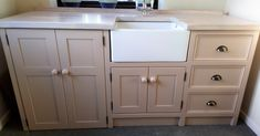This Belfast sink unit would be perfect for a utility room- the large double doors are designed to house an appliance..such as a washing machine or tumble dryer,alongside plenty more storage in lovely deep drawers and an undersink cupboard.The solid pine unit has been painted in Farrow and Balls 'jitney' and also features a limed oak worktop,which has been treated with layers of waterproof wax making it durable as well as a thing of beauty!