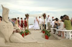 Do use the sand as part of your beach wedding decor.