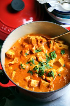 An easy vegan Indian vegetable korma recipe with tofu, cauliflower, coconut, and warming spices. Healthy and easy. | yummybeet #Korma #Cauliflower #Tofu