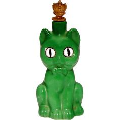 Here is a wonderful vintage Art Deco era Goebel figural GREEN CAT crown top pefume with outstanding detail. MEASUREMENTS: inches tall not including height of crown stopper. CROWN STOPPER: - How fun! Antique Perfume Bottles, Vintage Bottles, Vintage Perfume, Art Deco Decor, Art Deco Era, Top Perfumes, Beautiful Perfume, Homestuck, Oeuvre D'art