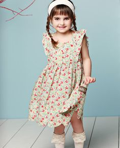 Matilda Jane Clothing.  Flutter sleeves from bottom of front bodice all way down back.  Scalloped hem.