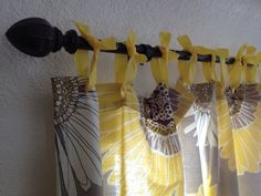 Hang a shower curtain with ribbons to make a no-sew curtain.