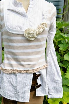 Cute sweater vest embellished with lace rosettes