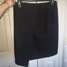 Kate spade wool mix skirt BRAND NEW Brand new kate spade skirt. Size 0. Wool mix. Has belt in front that wraps around skirt. Very unique. kate spade Skirts Mini