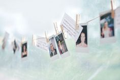 A clothesline holds Polaroid photos from the festivities and perforated pieces of the ceremony programs containing inspirational words.