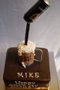 This super cool Beer Mug Cake was designed for a Guinness fan. The 3-Dimensional Beer Mug features a suspended Guinness Beer can.