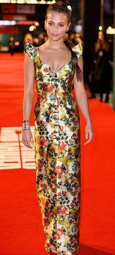 "Alicia Vikander in Louis Vuitton attends the London premiere of ""Tomb Raider"". #bestdressed"
