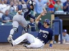Game #60 6/9/12: Milwaukee Brewers' Cody Ransom slides safely home to score on a Martin Maldonado single off San Diego Padres' Ross Ohlendorf during the fourth inning of a baseball game on Saturday, June 9, 2012, in Milwaukee. (AP Photo/Tom Lynn)