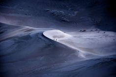A family hikes in the moonlight in Death Valley in this National Geographic Your Shot Photo of the Day.