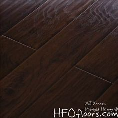 """AJ Trade AJ Trading Mega Clic Midnight hickory laminate 12 mm hand scraped, embossed 5.5"""" wide boards. Available at HFOfloors.com Hardwood Floors Outlet in Murrieta, Ca."""