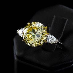 Tiffany & Co. GIA Cert 5.86 Carat Fancy Intense Yellow Round Diamond Ring | From a unique collection of vintage engagement rings at https://www.1stdibs.com/jewelry/rings/engagement-rings/