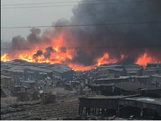 There is an ongoing fire outbreak which is raging through Makoko, a slum neighborhood located near the 3rd Mainland Bridge, Lagos.   The men of the fire service are yet to arrive the scene as at the time of this report   #Heavy Fire Outbreak At Makoko Slum In Lagos #Properties Destroyed. Photos