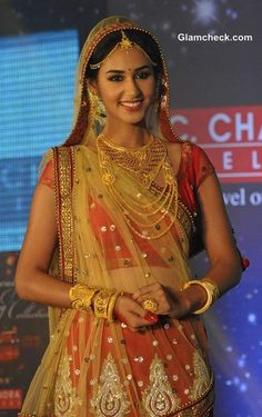 Indian bride wearing bridal jewellery, lehenga and makeup