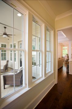empty nester by highland homes.  like the hallway coming from the garage to inside the house.  maybe have the laundry room, walk in pantry and a small walk in office on this hallway.