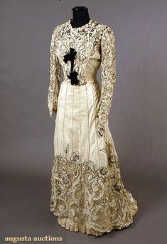 Paris Silk Cutwork Tea Gown, circa 1900 2-piece, cream silk crepe, cutwork edged in black embroidery.