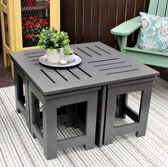 This stylish outdoor coffee table features four hidden side tables. The side tables quadruple the space for beverages and burgers!