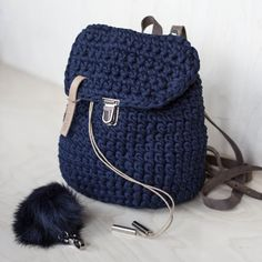 Casual rucksack is made of recycled fabric with synthetic or leather bands on your choice. It is crochet with special chunky yarn made of jersey cotton fabric. Basic dimentions: 12X14 (30Х35 cm) It has bucket shape with waxed cotton drawstrings and stopper on top. The top cap locks on