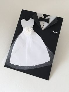 Wedding Card, Mr and Mrs, Bride and Groom Congratulations Card, Tuxedo - Wedding Gown Card, Wedding Money Holder Card  This listing is for one (1) Tuxedo/ Gown Card  Card measures approx: 4.5 x 6 Tag measures slightly smaller Card ships with envelope via USPS within 3-5  This card does not open as a traditional card. This is a pocket card, the tag pulls out. This card is handmade using black and pearl white card stock papers. Black paper is folded into a pocket, top cut to appear as a tu...
