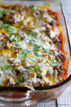 Taco Casserole - Biscuits are coated in taco sauce then topped with spiced ground beef and lots of cheese in this family friendly dinner idea.