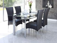 Contemporary Glass Dining Table Design Come With 2 Tier To Storage Space Together Four Stainless Steel Legs In Chrome And Black Leather Dining Chair Modern Style a part of under Dining Room Glass Dining Table Designs, Black Glass Dining Table, Black Leather Dining Chairs, Glass Dining Table Set, Round Dining Table Modern, Glass Dining Room Table, Modern Dining Chairs, Dining Table Chairs, Ikea Dining