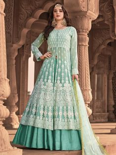 Sea green embroidered lehenga style suit for women available at Inddus. This elegant set comprises a viscose georgette anarkali kurta with silk pant also paired with net dupatta. Anarkali Lehenga, Lehenga Suit, Lehenga Style, Silk Lehenga, Anarkali Suits, Designer Anarkali, Designer Gowns, Designer Wear, Western Lehenga