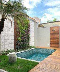 Small backyard pool with wooden decking and grass turf around it to reduce mantainence.The wall is treated with vertical garden, stone and woosen cladding as well. modern Backyard with pool Backyard pool with vertical garden. Small Backyard Design, Backyard Pool Designs, Small Backyard Landscaping, Modern Backyard, Small Patio, Backyard Patio, Small Pool Backyard, Small Garden With Pool Ideas, Narrow Backyard Ideas