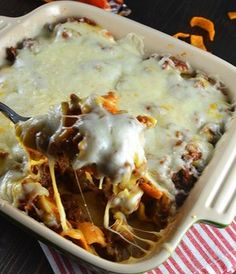 Frito Taco Bake - ground turkey instead of beef, cheddar instead of soup, and it's semi-healthy for grandkids!