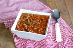 Slow Cooker Baked Beans: 2½ cups dried navy beans 8 oz bacon, cooked and diced (organic and/or local recommended) 1 green bell pepper, diced 1 onion, quartered 1 – 15 oz can plain tomato sauce ¾ cup pure maple syrup 3 tablespoons yellow mustard 3 tablespoons apple cider vinegar 1 teaspoon chili powder 1 teaspoon salt black or red pepper, to taste