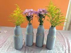 Resultado de imagen para centros de mesa con botellas