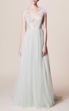 This sleeveless **Marchesa** gown features a plunging neckline and silk organza flowers at the bodice.
