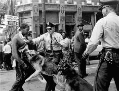 Black History Month Photo Of The Day (PHOTO) In this May 3, 1963 file photo, a 17-year-old civil rights demonstrator, defying an anti-parade ordinance of Birmingham, Ala., is attacked by a police dog. Bill Hudson, an Associated Press photographer whose searing images of the civil rights era documented police brutality and galvanized the public, died Thursday, June 24, 2010 in Jacksonville, Fla. He was 77. (AP Photo/Bill Hudson, File) http://www.huffingtonpost.com