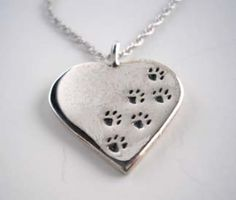 Paw prints track across your heart on this Sterling Silver necklace. What says I Love You better?