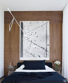 A 2013 untitled work by Adam McEwen stands out against a guest room's walnut paneling. What looks like abstract imagery is in fact an inkjet print of chewed gum on a sidewalk.