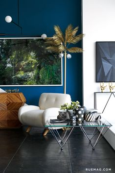 Blue wall and a brass palm tree <3