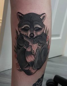 Aimee Bray raccoon tattoo