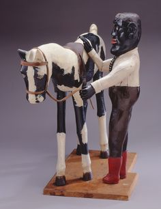 Edgar Tolson (American, 1904–1984)  Man with Pony, ca. 1958  Carved and assembled painted wood  23 x 11 1/4 x 32 in. (58.42 x 28.58 x 81.28 cm)  The Michael and Julie Hall Collection of American Folk Art