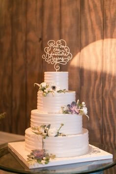 Anemone and succulent topped wedding cake: http://www.stylemepretty.com/2017/02/28/a-whimsical-farm-wedding-for-meant-to-be-lovebirds/ Photography: Amy Rizzuto - http://amyrizzutophotography.com/ Assistant: Makina Saylor - http://mekinasaylor.com/