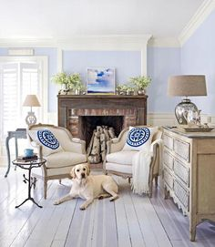 Powder Blue Room: High-gloss deck paint was used to create the stripes on the floor of this interior and Martin Senour's Silver Sequin for the walls. A painted Gustavian dresser and chairs are valuable antique additions. Matching pillows are from the Sandor Collection.