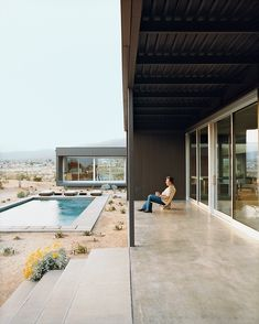 At the Desert House, designed by Marmol Radziner in Desert Hot Springs, California, groupings of succulents accent the home's entry path and pool area.