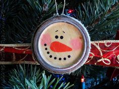 This snowman ornament is two sided. In this project we'll use Antique Mod Podge over white fabric to give these snowman that aged look. Chances are you have some canning lids and bands lying around. Turn them into a rustic snowman ornaments with a vintage feel. Rusty canning bands are ideal for this craft!
