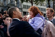 President Barack Obama greets a little girl following his remarks during the Irish celebration at College Green in Dublin, Ireland