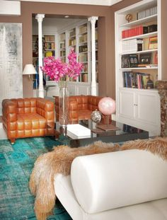 Design  Gonzalo Garcia via Elle Spain That caramel leather on the turquoise rug rocks my world.