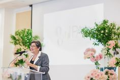 President Carol Rosen speaking. WIPA June 2012 Meeting -- The Art of Photography at the Pacific Club (photo by Jasmine Star Photography).