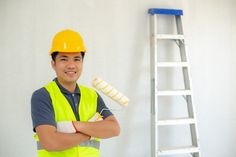 Asian Smiling painter holding a paint roller and backdrop has an aluminum ladder, Portrait of happy mature man looking at camera isolated over White wall. Satisfied handyman with copy space. Apartment Painting, House Painting, Aluminium Ladder, Professional Painters, Best Commercials, Painting Services, Mature Men, Men Looks, Interior Paint