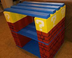 Using cinder blocks, plywood and Mario themed. Kids Aquarium, Diy Aquarium Stand, Aquarium Ideas, Fish Tank Stand, Fish Tank Accessories, Aquatic Turtles, Kids Living Rooms, Future Boy, Cinder Blocks