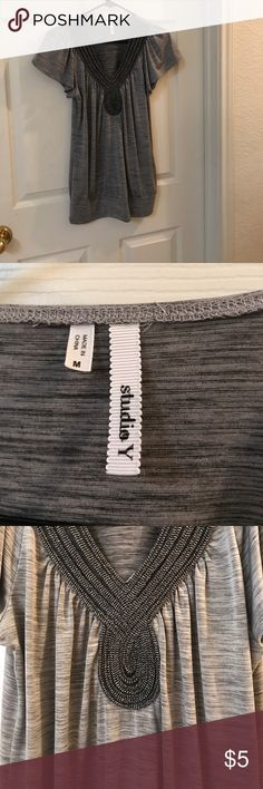 Grey and black V neck Grey and White V Neck. Very comfortable. No flaws! Tops Blouses